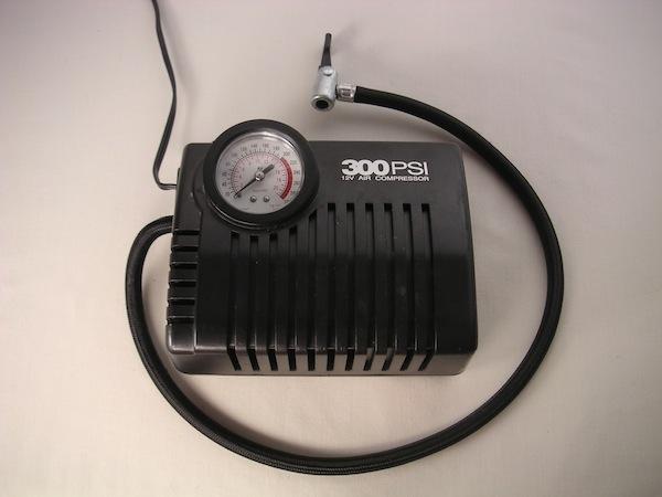 Vintage electric air compressor illustration.